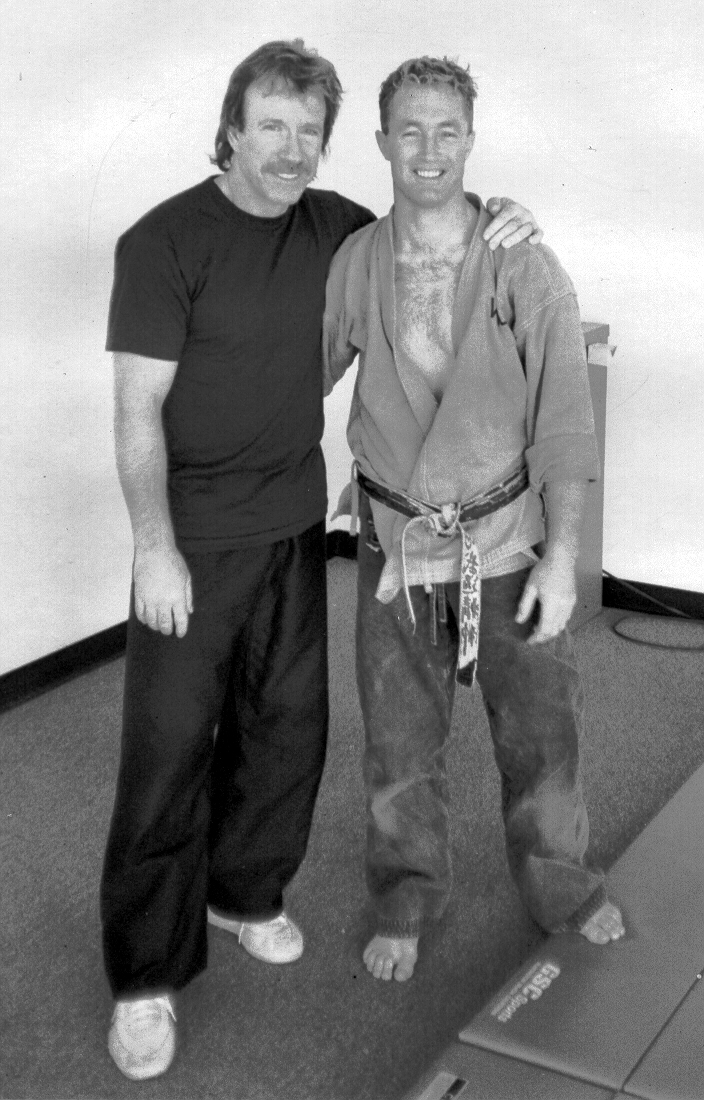 Artemis BJJ Brazilian Jiu Jitsu Bristol interview with John Will, shown with Chuck Norris, 1990s